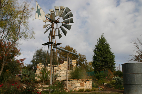 Windmill fountain with homestead ruins
